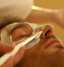 A man receives a facemask treatment in the beautyfarm